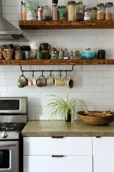 concrete countertops- not mixed or polished give a pricer natural stone look.