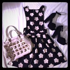 NWT Daisy open-side dress. NWT Black with white daisies. Open sides, cute with bralette. Hits above the knee. Tag fell off when trying on the dress, but it has never been worn. one clothing Dresses