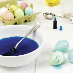 Using a fork, stir the oily liquid to create swirls on the surface. Holding a dyed egg in your hand, place it in the mixture and roll the whole surface of the egg around once to pick up the oil streaks. Pat the excess liquid with a paper towel and allow to dry.   - Delish.com