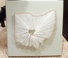 DIY state heart string and pin wall art. I want to make one of these for every state we've lived in over the years. I would make for a great wall collage as we get older!