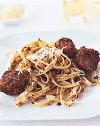Olive-Mint Pesto Meatballs with Fettuccine | Some cooks are surprised when F&W's Grace Parisi tells them she mixes pesto into meatballs to add flavor quickly.