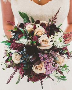 The colors in this bouquet  really compliment each other! So perfect for a fall wedding!