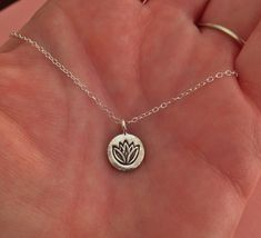 want! Tiny Lotus Necklace in Sterling Silver by TangerineCrimeScene, $26.00