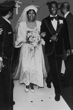 Franklin wore an ankle-length white dress to marry actor Glynn Turman at her father's New Bethel Baptist Church in Detroit, Michigan. The soul singer completed her wedding day ensemble with a brocade robe trimmed in fur and ending in a train that followed her up the aisle. #southernfashion #vintageweddingdresses #iconicweddingdresses #vintagesouthernstyle #southernliving