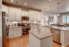Traditional Kitchen with U-shaped, Hardwood floors, Raised panel, African Rainbow Granite Countertop, Flat panel cabinets