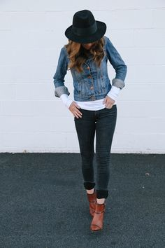 Black jeans, jean jacket, hat, booties