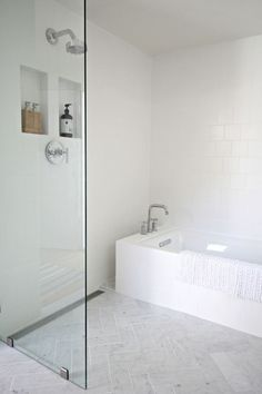 I like the minimal amount of glass/no door shower tub sitch. Designed by Kirsten Grove of Simply Grove