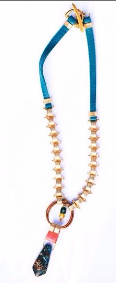 Turquoise leather and gold plated chain add a Pop of color to any outfit. I have always loved the notion of the eye in many cultures. As a sign of