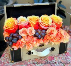Suitcase flower boxes for Honeymoon theme bridal shower
