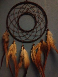 Brown faux suede trim dream catcher, brown web, rooster feathers and hoop insert finish 15cm diameter dreamcatcher hand made on Etsy, £9.50