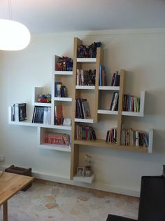 Cool tree of shelves - though I'd prefer one color only... maybe even all brown, with green frames of family photos to make a 'family tree' ?