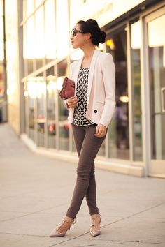 I like how a light-colored blazer is paired with a patterned top.