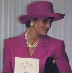 On June 14, 1993, Diana attended the Most Noble Order Of The Garter procession and service at Windsor Castle.  She wore a stunning fuchsia pink two-piece suit by designer Catherine Walker, worn with a matching coloured hat, black gloves, and hosiery, and black patent leather court shoes.