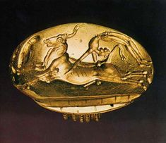 Bull-leaping. Gold Minoan signet ring, ca. 1700 BC, from Arkanes, Crete.