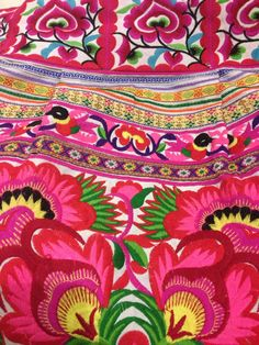 Embroidery overload! Neon pink and red floral motifs stand out on this piece. Taken by Homebuildlife