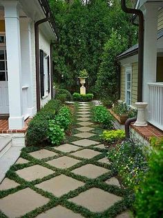 Manicured courtyard garden with grass-trimmed tiles