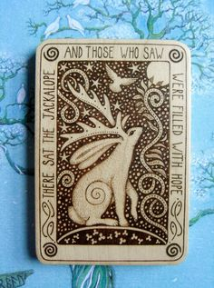 Hug-the-Tree Pyrography  Little Wooden Miniatures'    'The Jackalope'    Words round the edge read: 'There sat The Jackalope, and those who saw were filled with hope..'  - Part of a story I need to write..maybe one day..