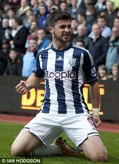 Liverpool are considering a £12million January bid for West Brom striker Shane Long.