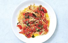 Spaghetti with Tomatoes and Anchovy Butter Recipe - Bon Appétit--spaghetti? Good. Tomatoes? Good! Anchovies? ALL GOOD! Can't wait to try!