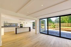 Using our aluminium sliding doors, bespoke window arrangements and large gable end windows we were able to create a beautiful contemporary home design. Home Building Design, Building A House, House Design, Aluminium Sliding Doors, Aluminium Windows, Open Plan Kitchen Dining Living, Mansions Homes, House Extensions, Window Design