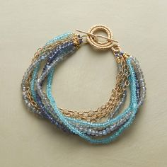 """LABYRINTH BRACELET -- Strands begin and end with a labyrinthine toggle clasp, a meditative mix that includes labradorite, apatite and iolite, 14kt gold filled. Handmade exclusive. 7-1/2""""L."""