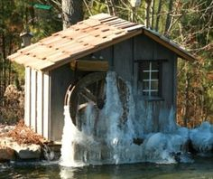 """If there's one thing I want, it's water features that are self-powered. A water wheel mounted on the side of the garden shed could be perfect. See """"Water Wheel Electricity"""" page."""