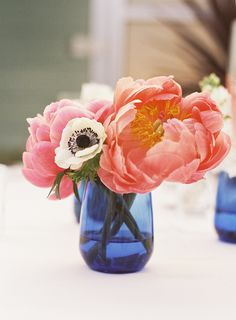 Pretty mix of blue vases, peonies and anemones! See the wedding on SMP: http://www.StyleMePretty.com/california-weddings/2014/03/28/manhattan-beach-wedding-at-the-shade-hotel/ Photography: Susan Dean - susandeanblog.com