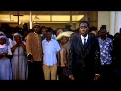 Hotel Rwanda trailer. How does the Rwandan genocide compare to the witch hunts in The Crucible?