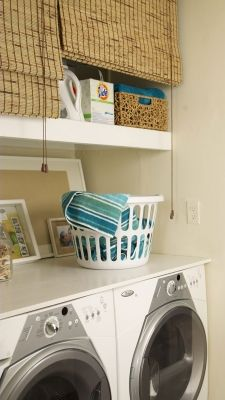If you don't have cabinets in your laundry room, just hide messy shelves full of detergent and supplies behind bamboo blinds.