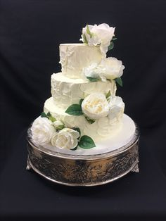Rustic Buttercream Wedding Cake with White Florals and Greenery