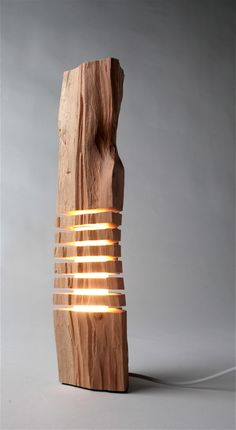 From Paul Foeckler's aptly-named Split Grain brand of sculptures comes a simplistic but wholly intriguing set of illuminating pieces, all of them carved from California cypress. Wood Floor Lamp, Floor Lamps, Room Lamp, Unique Lamps, Cool House Designs, Wood Sculpture, Wood Design, Design Art, Wood Art