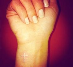 white ink cross tattoo. love love love love love.
