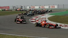 Fernando Alonso leads with Ferrari F138 in 2013 Chinese F1 GP