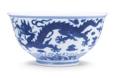 BLUE AND WHITE 'DRAGON' BOWL ZHIYUANTANG ZHI MARK, QING DYNASTY, 18TH – 19TH CENTURY with deep rounded sides rising to a flared rim, the exterior decorated with two five-clawed scaly dragons striding amidst scrolling clouds and above tumultuous waves crashing on stylised rocky mountains, the base inscribed with a hall mark reading Zhiyuantang zhi (made in the Hall of Extended Remoteness) within a double-square 9.5 cm, 3 3/4  in.