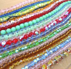 LOT 24 strands glass beads is going up for auction at  12pm Sat, Apr 27 with a starting bid of $5.