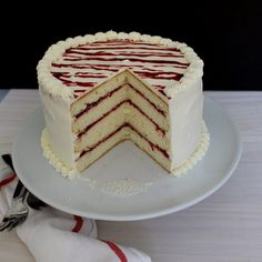 This tender, fluffy, buttery vanilla cake is filled with raspberry jam and topped with a stunning white chocolate Swiss meringue buttercream.
