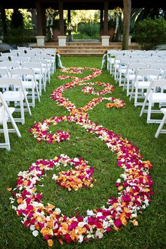 Outdoor wedding ceremony aisle with a design of pink, orange and white petals - photo by top Atlanta-based wedding photographer Scott Hopkins Photography