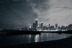 Chicago skyline seen from North Avenue beach. I did a long exposure to get that glassy look in the water. Looks like Gotham City to me.