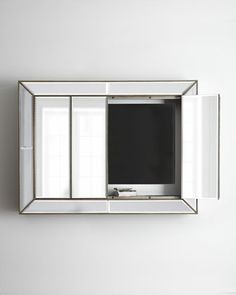Murano Plasma Wall Cabinet . - keeps your flat screen TV out of sight until your ready for it and serves as a mirror in the meantime....