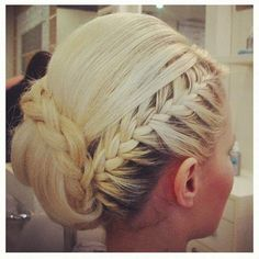 braided updo...I wish I coul see what the rest of this looks like!
