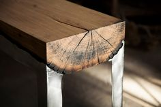 Furniture designer Hilla Shamia melds cast aluminum with tree trunks to create this beautiful line of tables and benches