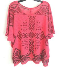 """HeartSoul 3X Coral Tribal Print Knit Top This HeartSoul Jr Plus 3X Coral Tribal Print Knit Top is in great used condition. Short dolman sleeves, lightweight polyester knit. No fading, pilling, or stains.  (In my opinion Jr Plus 3X fits like womens 2X, but here are measurements so you can verify size.) Bust: 28"""" across laying flat (56"""" around). 25.5"""" long. ::: Bundle 3+ items from my closet and save 30% off when you use the app's Bundle feature! ::: No trades. HeartSoul Tops"""