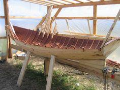 Fofan boat in preparation , Onega lake embankment Karelia, North Russia