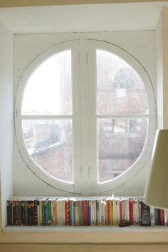 A window seat full of books. Well i would actually sit on the window seat and read but either way it works
