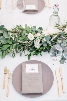 a great list of the best wedding table decorations, wedding table settings with lush greenery, gray tableware