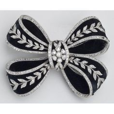 Bowknot Brooch, ca. 1905; Gold, platinum, diamonds, velvet, enamel.