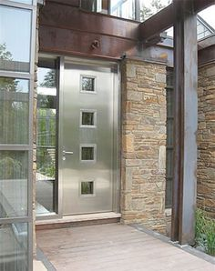 Love the front door and this whole front walk up area!  Stainless steal is the new trend.