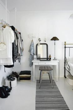 love the open and hanging rack closet // awesome small space idea. Plus the color palette in here is awesome!