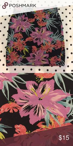 multicolored flower-print bodycon skirt this skirt is black with purple, blue, neon green, and coral colors in the flowers. it fits tight since it is bodycon, and is fairly short. it has never been worn and is in very good condition. Garage Skirts Mini