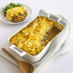 Vegetarian cottage pie with swede crust and mixed vegetables, including peas, beans, mushrooms
